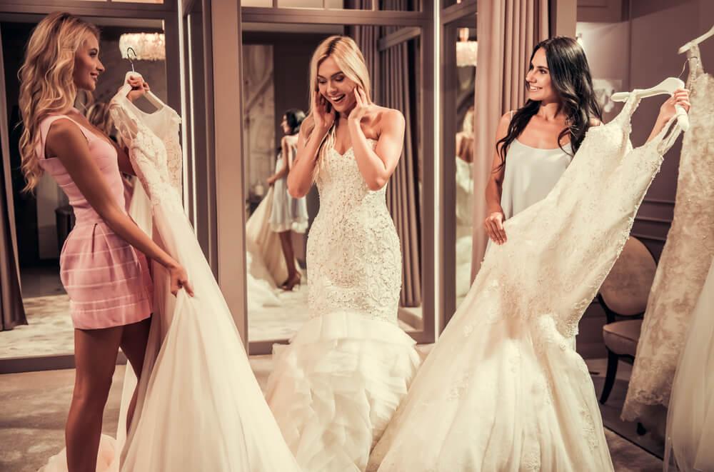 Girls checking wedding dress