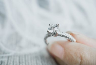 Holding a diamond ring with thick girdle