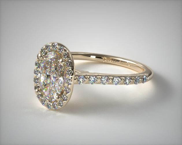 Oval halo engagement ring yellow gold