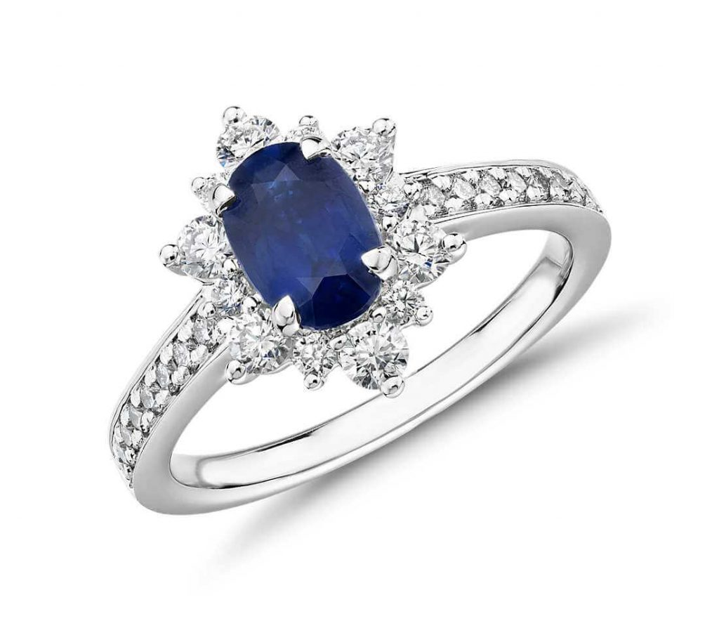 Oval blue sapphire engagement ring halo setting