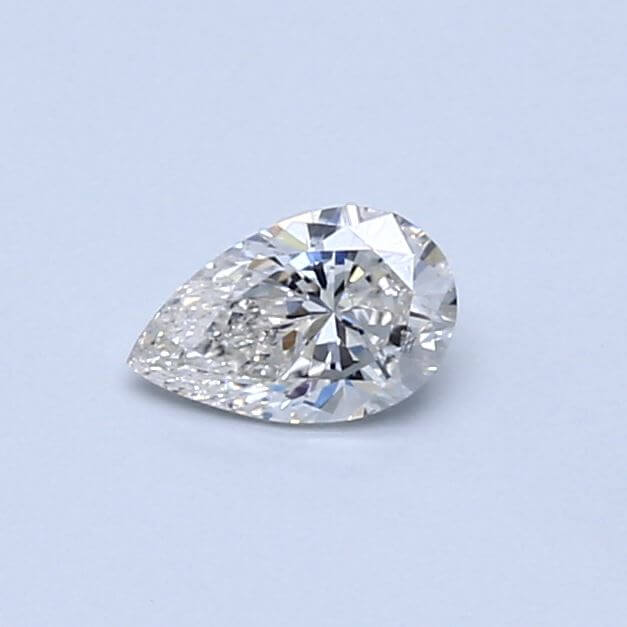 Pear shape diamond close up on blue background