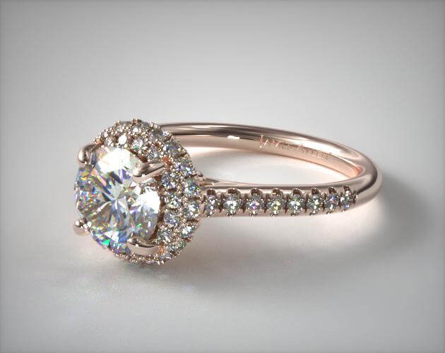 Rose gold halo ring with round diamond color D