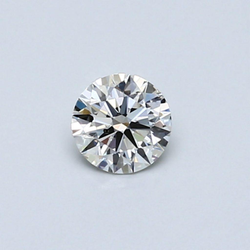 Round shape diamond close up on blue background