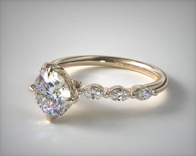 Round shape diamond engagement ring yellow gold
