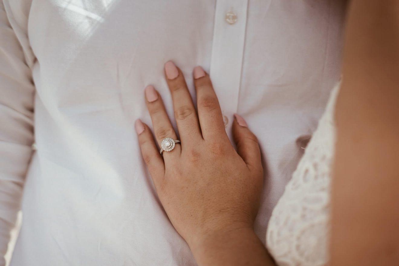 Girl wearing k color diamond engagement ring