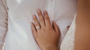 Girl wearing k color diamond engagement ring