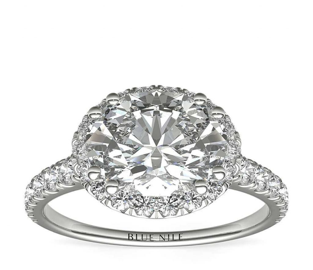 Side oval halo engagement ring