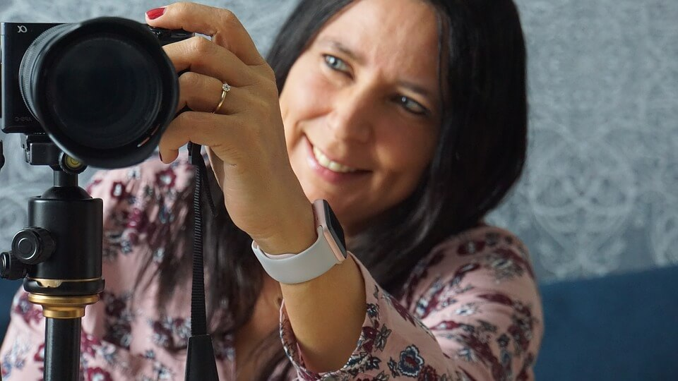 Woman fixing her camera