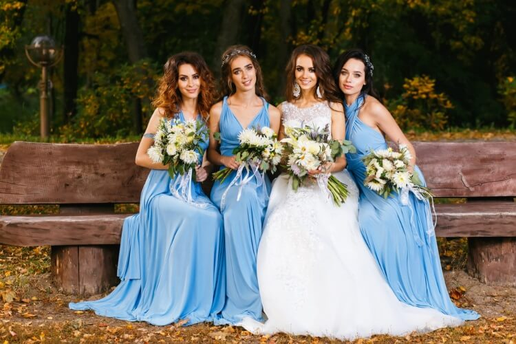 Bridesmaids with blue dresses