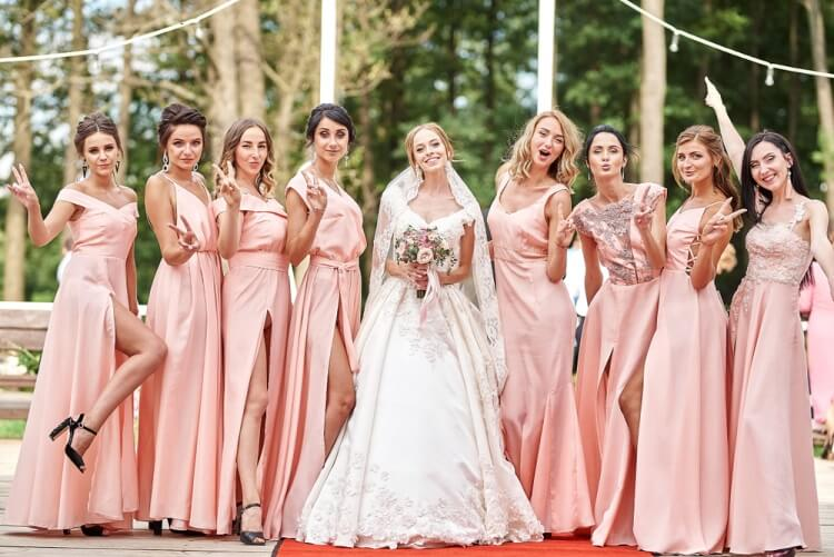 Bridesmaids wearing similar dress