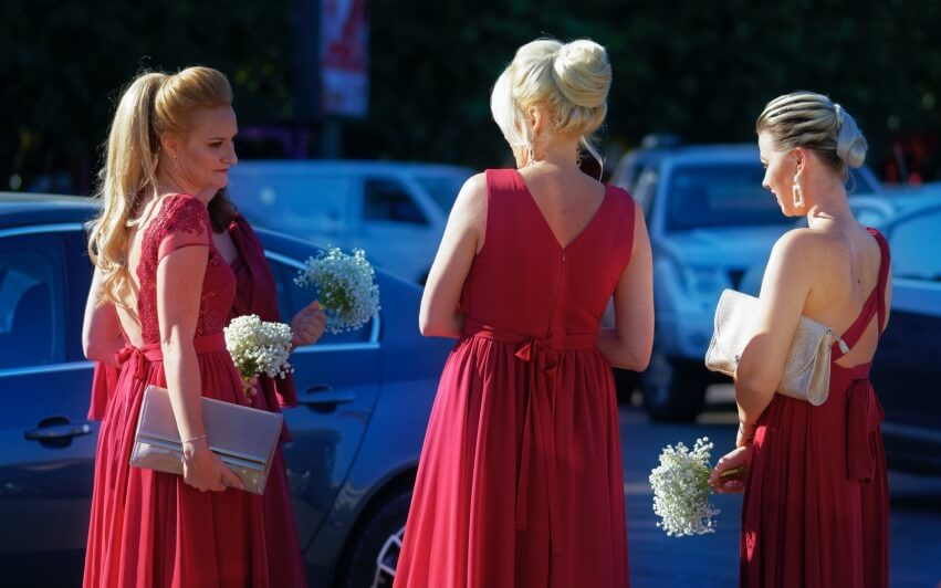 Bridesmaids wearing classic jewelry