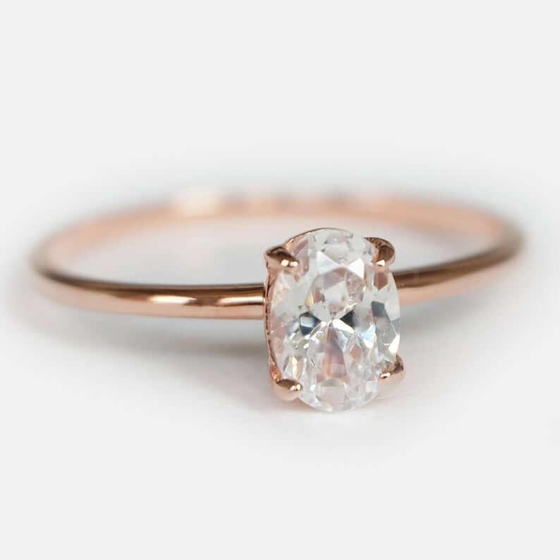 Oval shape white topaz ring