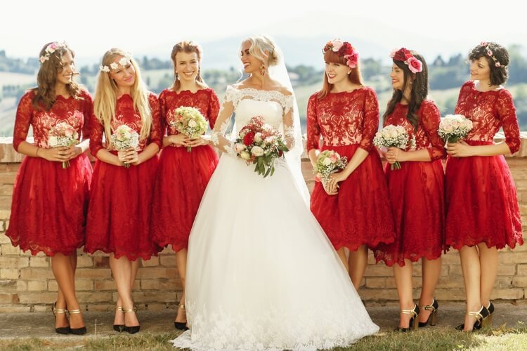 Bridesmaids wearing similar dresses