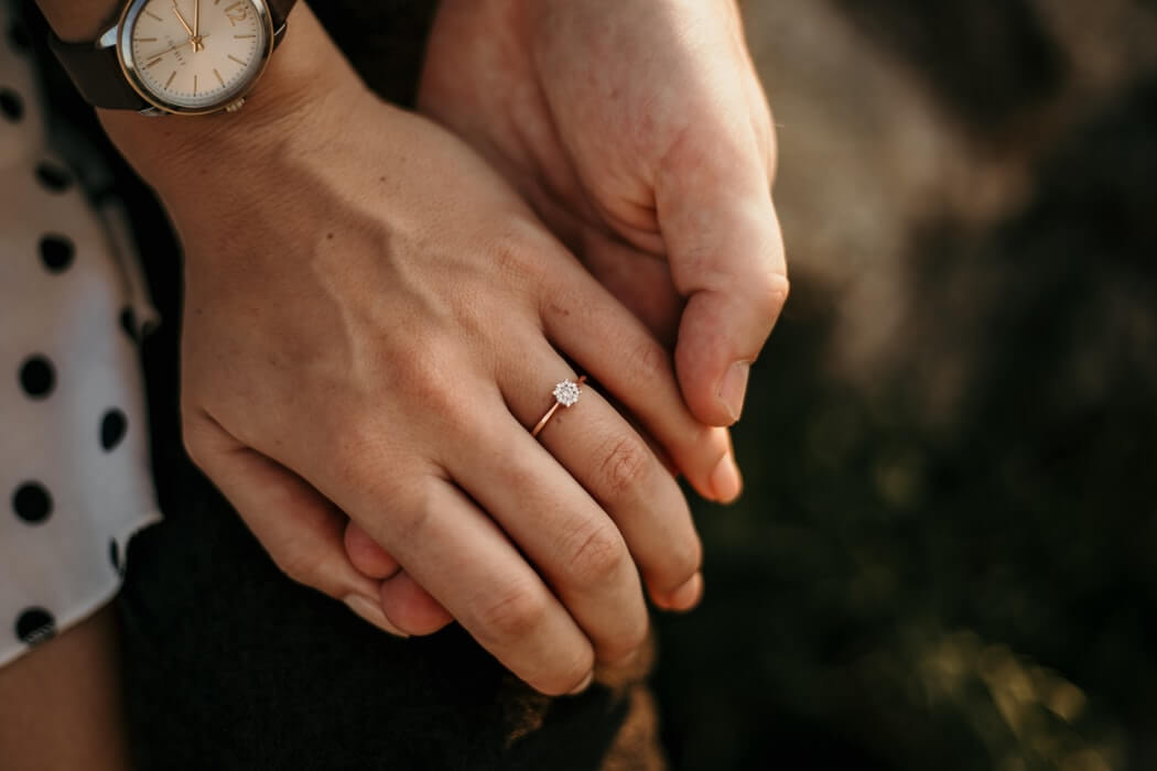 Bride wearing solitaire diamond ring