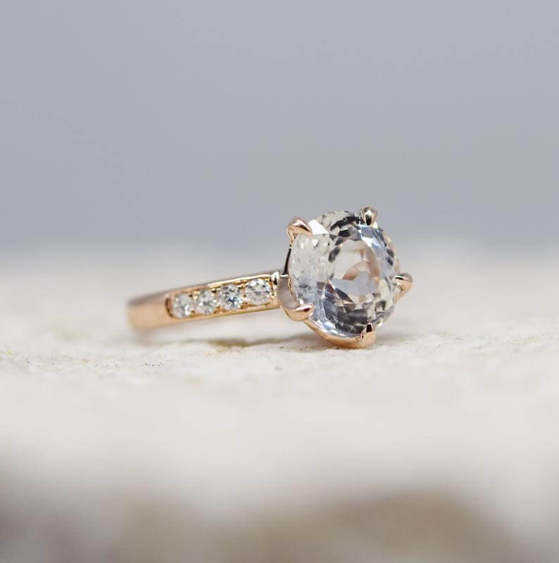 Solitaire white sapphire ring