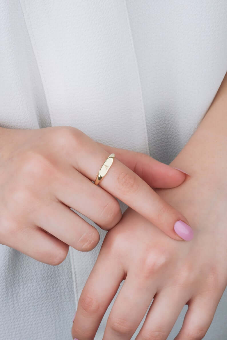 Girl wearing gold plated ring