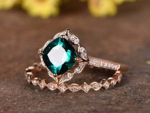 Green emerald engagement ring