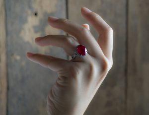 Ruby ring on finger