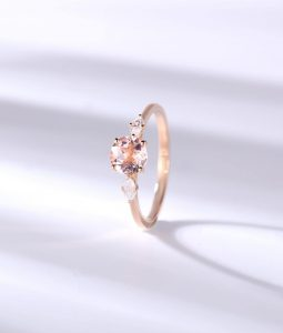 Dainty three-stone engagement ring