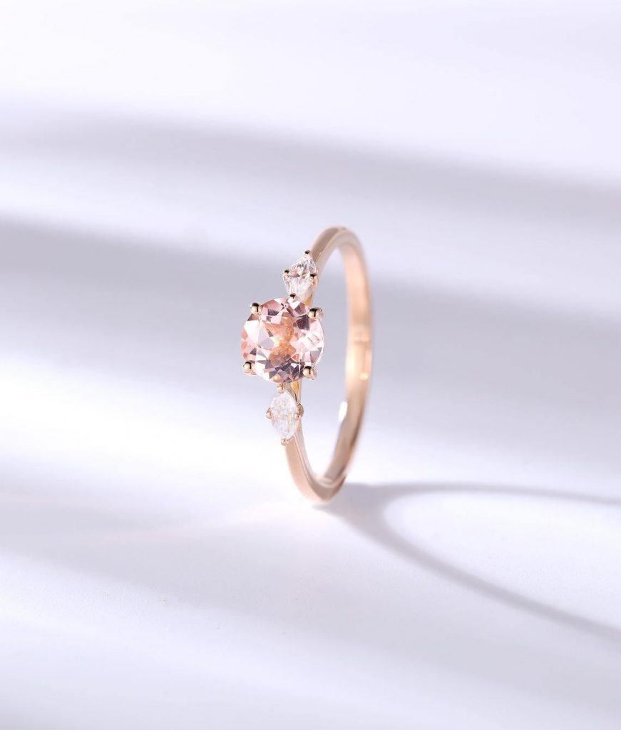 Dainty three-stone engagement ring