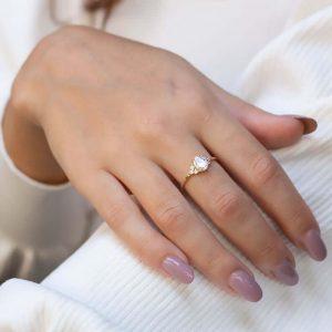 Girl wearing white sapphire ring