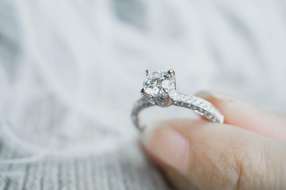 Holding diamond engagement ring