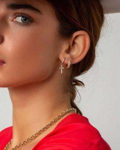 Girl wearing huggies earrings