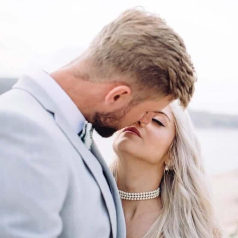 Bride wearing pearl strand choker