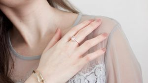 Girl wearing diamond promise ring