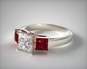 Three stone ruby and diamond engagement ring
