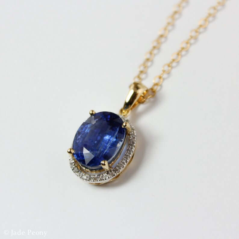 Kyanite pendant with halo