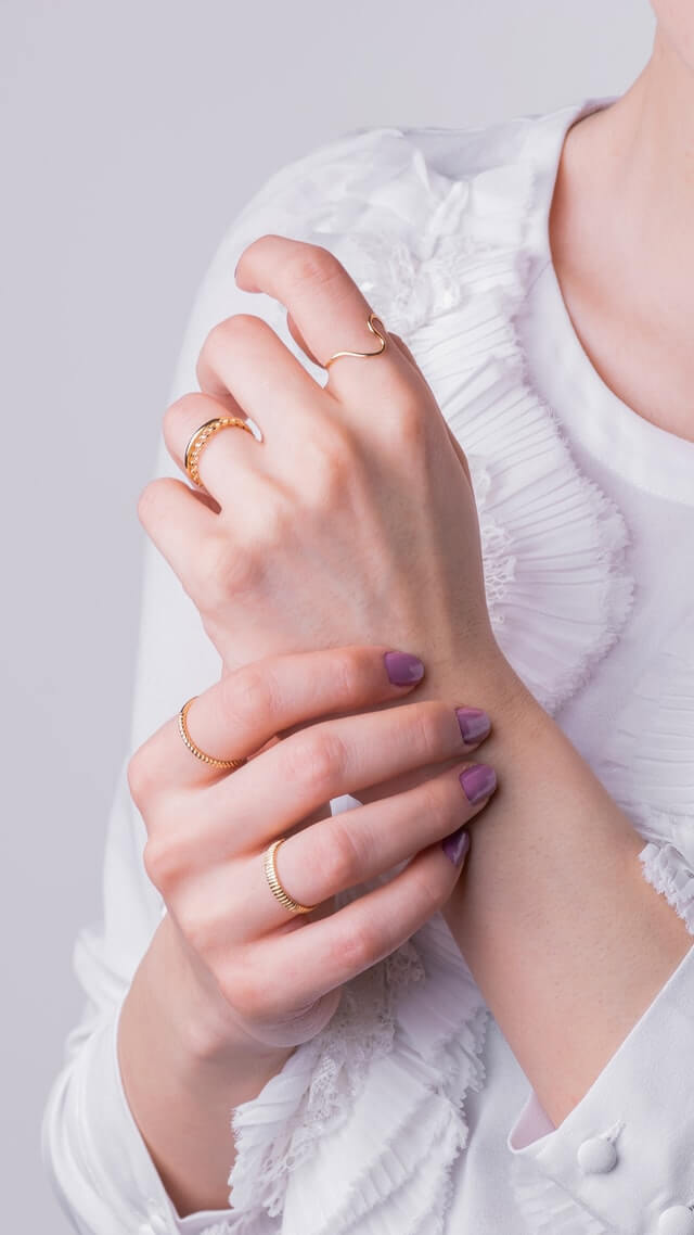 Girl wearing solid gold rings