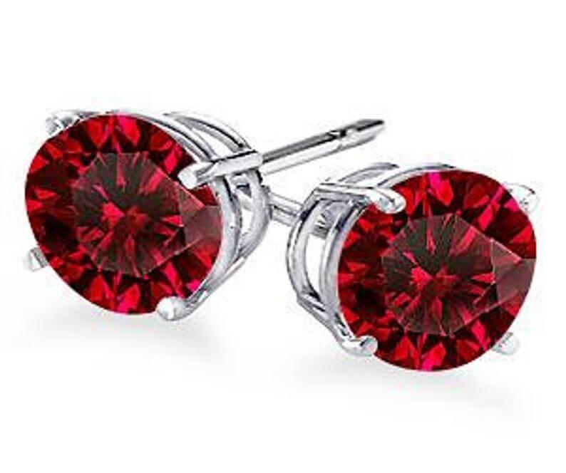 White gold ruby stud earrings