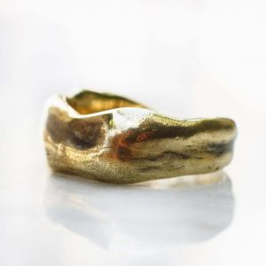 Asymmetrical hammered gold ring
