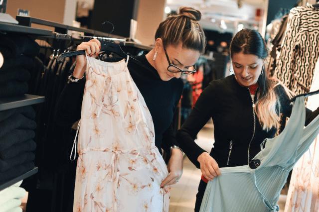 Bride and bridesmaid shopping