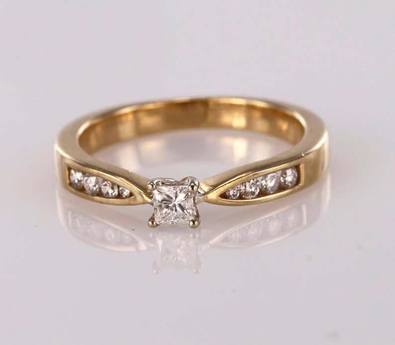 diamond ring with round cut diamond accents