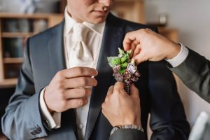 How to pin a boutonniere the right way