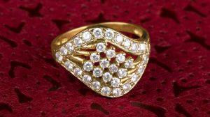 Melee diamonds engagement ring