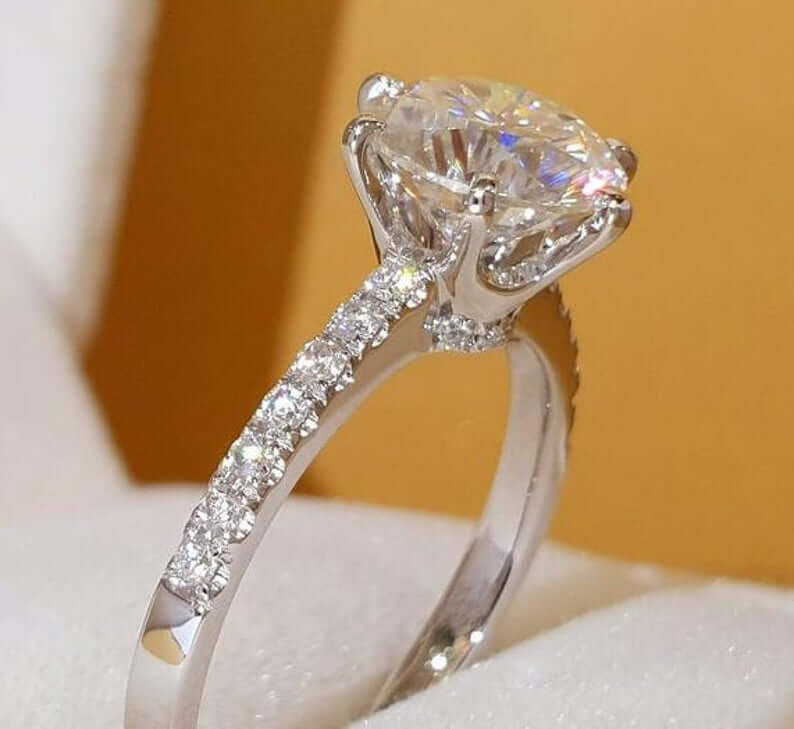 Moissanite ring with pave setting