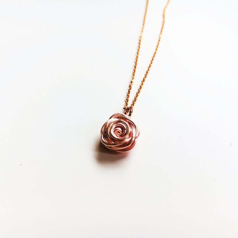 Rose gold rose pendant