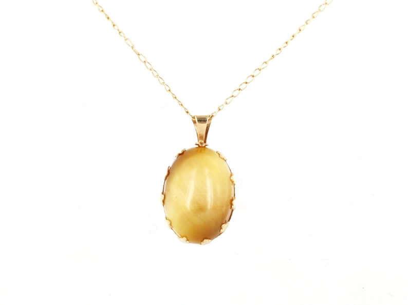 Yellow gold chrysoberyl pendant