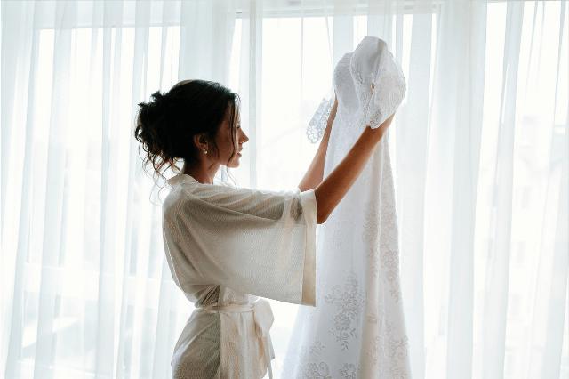 Bride donating her wedding dress